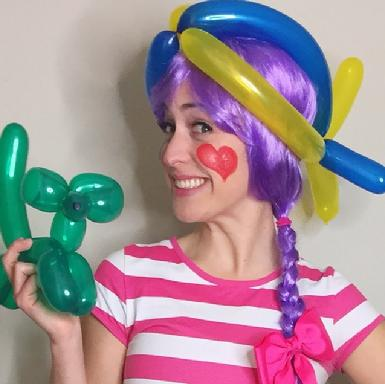 purple hair female clowns with balloon hat and animal professional kids birthday parties entertainers