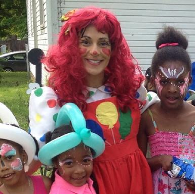 red hair female clown balloon artist face painter professional middle tn childrens party entertainment